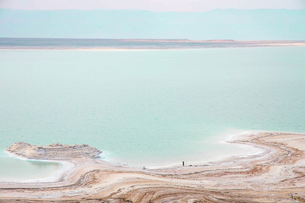 Stunning colors of the Dead Sea with tiny people.