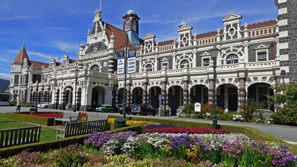 the front of dunedin railway station in new zealand
