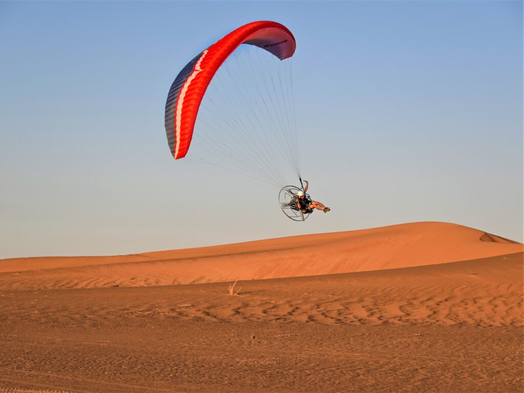 Guy in Dubai paramotoring over the UAE desert