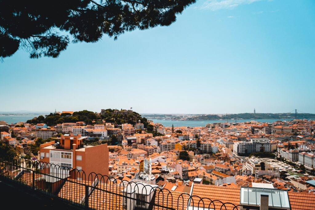 Panoramic view of orange houses by the sea in Lisbon, Portugal.