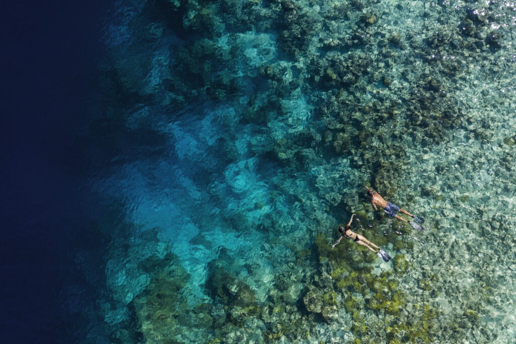 A couple snorkelling in the reefs of Ithaafushi private island