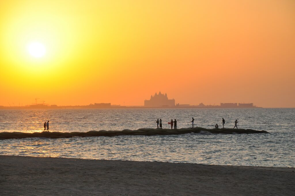 sunset over beach and see in Dubai