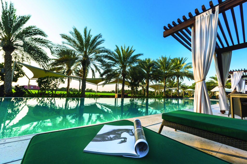 Spend the day relaxing at the infinity pool. Image Credit   Meliã Desert Palm Dubai